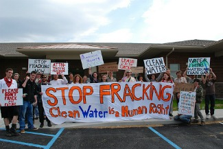 Mountain Justice activists raise hell outside a fracking office