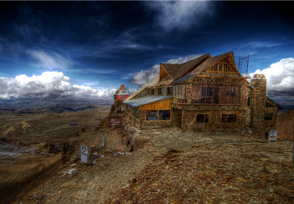 The lodge at Bolivia's Chacaltaya Glacier was once the world's highest ski resort—until the glacier melted away almost entirely in just 20 years. The lodge closed its ski facilities in 2009 and stands today amid a rocky, almost snowless moonscape. Photo courtesy of Flickr user ksfc84.