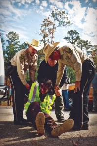 PHOTOS BY TAR SANDS BLOCKADE / LAURABOREALISA protester is arrested outside Wells, Texas.