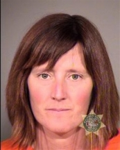 This undated photo provided by the Multnomah County Sheriff's Office in Portland, Ore., shows Rebecca Rubin, 39, of Canada, who turned herself in to face federal charges alleging she was part of a radical environmental group based in Eugene, Ore., known as The Family. Federal authorities blame the group for 20 fires across the West between 1996 and 2001 that did $40 million in damage. Rubin was to be arraigned Friday, Sept. 11, 2013 in U.S. District Court in Eugene, Ore., on conspiracy and arson