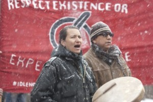Klee Benally leads the drum circle during an Arizona Snowbowl protest, the protest took place at heritage square in downtown Flagstaff on Saturday. Arizona Snowbowl has been using reclaimed water to blow snow onto the mountain which started in December of last year. (Photo by Jeff Bucher)