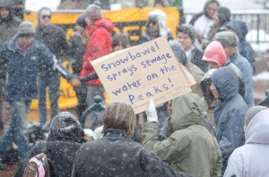 A protestor displays a sign during an Arizona Snowbowl protest, the protest took place at heritage square in downtown Flagstaff on Saturday. Arizona Snowbowl has been using reclaimed water to blow snow onto the mountain which started in December of last year. (Photo by Jeff Bucher)