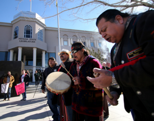 From left, Martin Cueva, Ocelotl Ortiz and Pete Casillas Jr. perform a Round Dance in front of the Legislative Building in Carson City on Monday. The rally was held in support of a bill that would prevent hunting of black bears in Nevada.