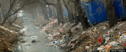 Trash clogs up a polluted canal at the edge of Beijing on March 16, 2012. China said that two-thirds of its cities currently fail to meet new air-quality standards introduced this week that are based on the pollutants most harmful to health. (MARK RALSTON/AFP/Getty Images)