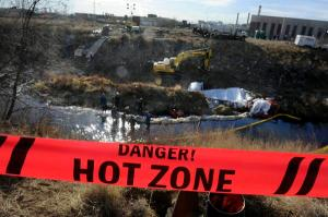 """Workers contracted by Suncor use vacuum trucks and absorbent material to suck up water mixed with an unidentified liquid leaking into Sand Creek north of downtown Denver on Nov. 30, 2011  Read more: Toxics from Suncor refinery spill still seeping into water; Colorado vows to """"accelerate"""" response - The Denver Post http://www.denverpost.com/news/ci_19787661#ixzz2MW3jlpzN Read The Denver Post's Terms of Use of its content: http://www.denverpost.com/termsofuse Follow us: @Denverpost on Twitter   Denverpost on Facebook"""