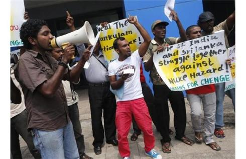 Dozens of protesters from Greens for Chenge, an environmental protection group, shout slogans during a protest opposite the Indian embassy in Colombo, Sri Lanka, Tuesday, March 5, 2013. The protestors were demanding a halt to the Russian-built Kudankulam nuclear power plant being built in southern India.
