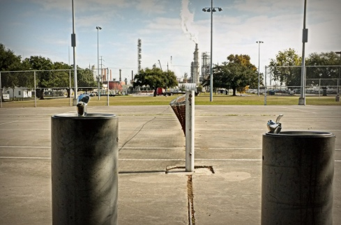 The Valero refinery overlooks Manchester;s only park. Photo by Laura Borealis