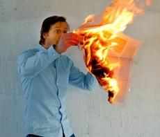 newspaper-on-fire