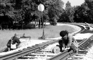 Members of the French underground sabotage German supply lines by blasting trains