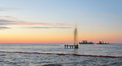 "A ""small"" spray of crude gushes into the Gulf after a boat crashed into a wellhead."