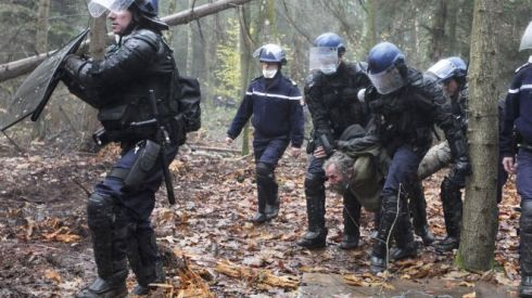 This Nov. 24, 2012 file photo shows French gendarmes detaining a protester during an evacuation operation on land that will become the new airport in Notre-Dame-des-Landes, western France. An unlikely alliance of anarchists and beret-wearing farmers is creating a headache for President Francois Hollande's beleaguered government by mounting an escalating Occupy Wall Street-style battle that has delayed construction on the ambitious airport near the city of Nantes for months. (AP Photo/Laetitia Notarianni, File) (The Associated Press)