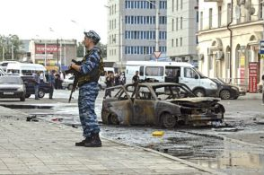 A policeman keeps watch at the site of a suicide bombing in Grozny, the capital of Chechnya, on September 16, 2009. (S. Dal/Reuters)