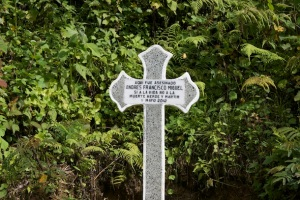 A stone cross commemorates the death of Andrés Francisco Miguel, who many believe was a victim of Guatemala's ongoing political repression. (WNV/Marta Molina)