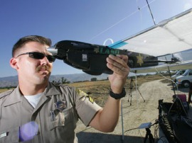 When the awful power of cop mustaches and surveillance drones unite, we all lose.