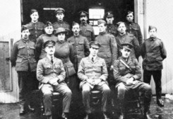 That's Low, at center front, surrounded by a crew of other sour faced chaps of the Experimental Works staff of the Royal Flying Corps.