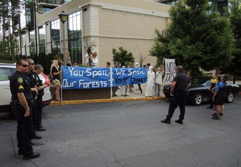 """You Spoil Our Forests – We Spoil Your Dinner"" banner refers to blocking conference participants from attending an exclusive dinner at the Biltmore Estate – birthplace to industrial forestry in the US."