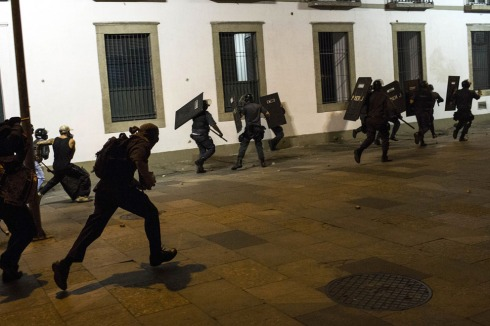 Chased by demonstrators, police officers retreat during a protest near the state legislative assembly in Rio de Janeiro, on June 17, 2013. (AP Photo/Felipe Dana) See more photos here