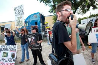 Gary Serignese, Executive Director of South Florida Smash HLS, leads a demonstration outside Primate Products, Inc. in Doral, near Miami International Airport. (CRISTOBAL HERRERA / Sun Sentinel SoFlaShare / September 22, 2011)