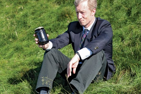 """The """"green"""" billionaire sitting with a jar of crude."""
