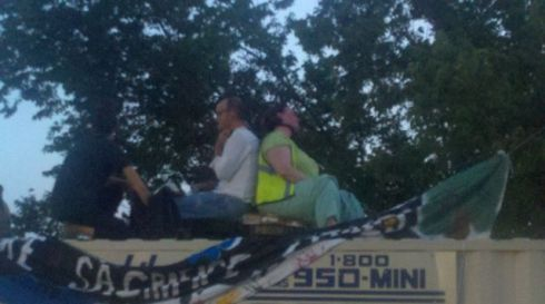 Two protesters have locked themselves together on a conex container on site