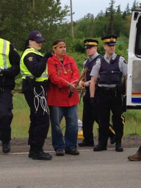 A man is arrested by the RCMP this morning near Elisipogtog First Nation. Photo courtesy @1tnb