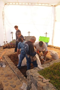 In this photo released by Chile's Judiciary, forensic specialists dig at the grave of Nobel laureate Pablo Neruda as they prepare for the exhumation of the remains in Isla Negra, Chile, Sunday April 7, 2013. (AP Photo / Judiciary of Chile)