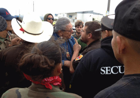 Oglala Sioux President Brewer being harassed before arrest.