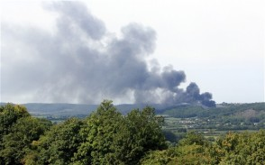 A fire at a police training area in Portishead, Bristol, sends out a giant plume of smoke. An anarchist group opposed to the badger cull has claimed responsibility for the fire which gutted a £16million police firing range Photo: SWNS.com