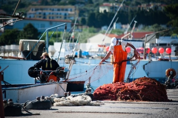 A sailor prepares to head out to sea with five 2.5-kilometer nets in ant'Agata di Militello, Sicily; 2.5 kilometers is the legal limit, but Mediterranean fishermen often join multiple nets of this size together to get around the law