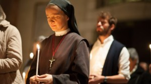 Catholic-nun-holds-a-candle-at-a-worship-service-via-Shutterstock-615x345