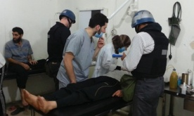 U.N. chemical weapons experts visit people affected by an apparent gas attack, at a hospital in the southwestern Damascus suburb of Mouadamiya. Photograph: Stringer/Reuters