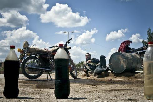 Abu Zechariah sells diesel and petrol per liter, and sometimes per half-liter.